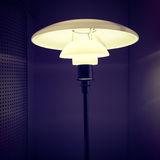 Stylish lamp in a dark room Royalty Free Stock Photos