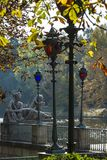 Stylish lanterns and sculptures in Lazienki Krolewskie park, Warsaw Stock Image