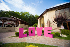 Stylish large pink Love sign, with big romantic letters, creativ Royalty Free Stock Images
