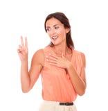 Stylish latin lady making a victory sign Royalty Free Stock Image