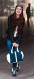 The stylish laughing girl  walks around the city Stock Image