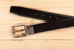 Stylish leather belt on table Stock Images