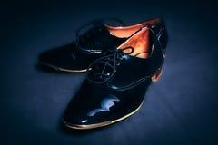 Stylish leather black shoes Royalty Free Stock Photos