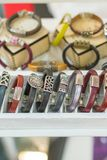 Stylish leather bracelets in the shop. Many various leather and textile bracelets. Leather multi-colored bracelets in the shop. Vertical photo stock photo