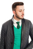 Stylish leather jacket over green sweater, white shirt and neckt Royalty Free Stock Photo