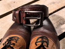 Stylish leather men's  shoes and belt Royalty Free Stock Photography