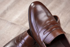 Stylish Leather Penny Loafer Shoes Placed On Mesh Surface Royalty Free Stock Photos