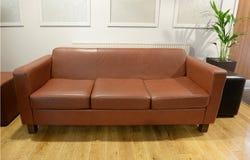 Stylish leather sofa Stock Photos