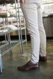 Stylish legs of employee standing Royalty Free Stock Image