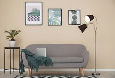 Stylish light room interior with comfortable sofa. Stylish light room interior with comfortable gray sofa stock photo