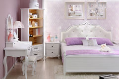 Stylish lilac bedroom with double bed Royalty Free Stock Photography