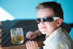 Stylish little boy drinking juice Stock Images