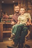 Stylish little boy and his father Stock Images