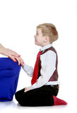 Stylish little boy on his knees admires her mother Royalty Free Stock Photos