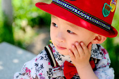 The stylish little boy leaning on his face Royalty Free Stock Photos