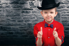 Stylish little boy in a shirt and hat.Trendy dandy. Stylish children`s clothing and accessories.The boy in the shirt and hat stock images
