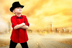 Stylish little boy in a shirt and hat.Trendy dandy. Stylish children`s clothing and accessories.The boy in the shirt and hat stock image