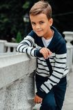 Stylish little boy in sunglasses and fashionable clothes . Children`s fashion Stock Photos