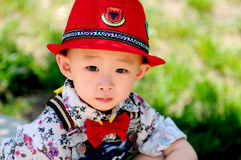 The stylish little boy wearing a red hat Royalty Free Stock Photography