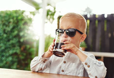 Stylish little boy wearing trendy sunglasses Royalty Free Stock Photography
