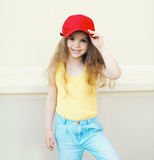 Stylish little cute girl child wearing a cap Royalty Free Stock Photos