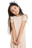 Stylish little dark-haired girl in a beige dress Stock Photography