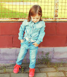 Stylish little girl child in the jeans clothes Royalty Free Stock Images