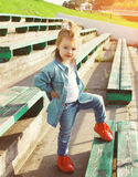 Stylish little girl child in the jeans clothes posing Stock Photos
