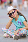 Stylish little girl child wearing a jeans clothes and sunglasses Stock Images