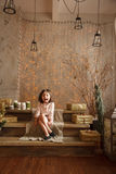 Stylish little girl in the christmas decorations shows her tongu Royalty Free Stock Photo