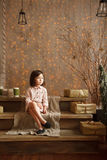 Stylish little girl in light pink dress sits in the christmas de Royalty Free Stock Images