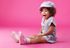 Stylish little girl playing up Royalty Free Stock Photos