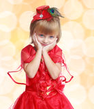 Stylish little girl in a red dress, close-up, pale Stock Image