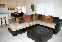 Stylish Living Room. A contemporary living room with large leather/suede sofa Stock Photography