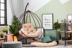 Stylish living room interior with comfortable armchair. Stylish living room interior with comfortable hanging armchair Royalty Free Stock Photos