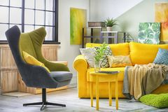 Stylish living room interior with comfortable sofa. And armchair Royalty Free Stock Photography