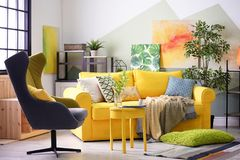 Stylish living room interior with comfortable sofa. And armchair Stock Photo