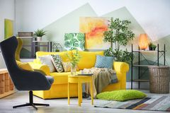 Stylish living room interior with comfortable sofa. And armchair Royalty Free Stock Images