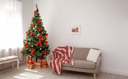 Stylish living room interior with decorated Christmas tree stock images