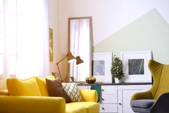 Stylish living room interior with large mirror. Idea for home decor Stock Photography