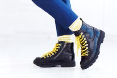 Stylish look of patent leather ankle boots with yellow shoelaces and socks at young boy. Kid Stock Image