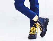 Stylish look of patent leather ankle boots with yellow shoelaces and socks at young boy. Kid Stock Photos