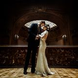 Stylish luxury bride and handsome elegant groom posing on the ba. Ckground of old wooden luxury interior royalty free stock images