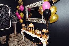 Stylish luxury decorated candy bat with balloons at the golden b. Irthday party, holiday celebration concept stock images