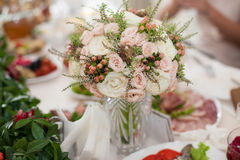 stylish luxury decorated tables for the celebration for a wedding of happy couple, and wedding bouquet royalty free stock photos