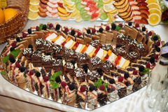 Stylish luxury decorated tables with sweets for a wedding of hap Royalty Free Stock Image