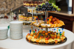 Stylish luxury golden decorated table with sweets and fruits for Royalty Free Stock Photos