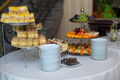 Stylish luxury golden decorated table with sweets and fruits for Stock Photography