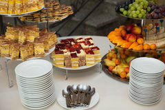 Stylish luxury golden decorated table with sweets and fruits for Royalty Free Stock Images