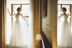 Stylish luxury gorgeous blonde bride posing on the background ho stock photos